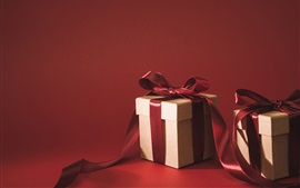 Gifts, ribbon, red background