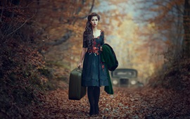 Girl in the forest, autumn, suitcase