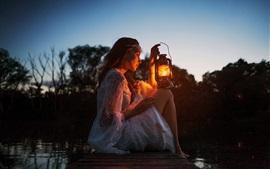 Girl, lamp, dock, river, darkness