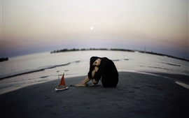 Girl sit on beach, toy boat, sea, mood