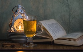 Preview wallpaper Glass cup, drink, book, candle, lamp