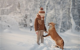 Little girl and fox are friends, snow, winter