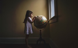 Little girl play globe, room, window