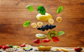 Vorschau des Hintergrundbilder Viele Arten Fruchtscheibe, Banane, Birne, Kiwi, Blaubeere, Erdbeere