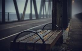 Metal bench, bridge, blurry