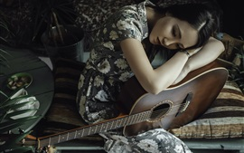 Preview wallpaper Sadness Asian girl and her guitar
