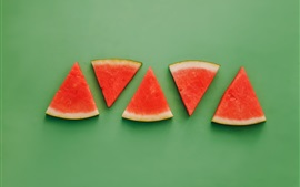 Preview wallpaper Watermelon slices, green background