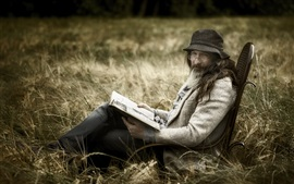 Preview wallpaper A man read book, glasses, hat, grass, chair