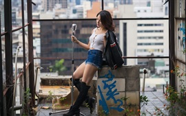 Preview wallpaper Asian girl, microphone, city