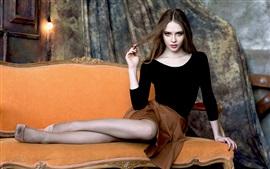 Preview wallpaper Beautiful girl, mesh socks, legs, pose, sofa