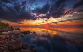 Beautiful sunset, nature landscape, lake, stones, clouds, red sky
