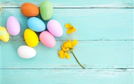 Preview wallpaper Colorful eggs, yellow flower, blue wood background, Easter