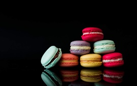 Preview wallpaper Colorful macarons, black background