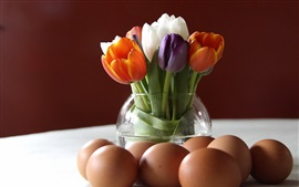 Colorful tulips, vase, eggs
