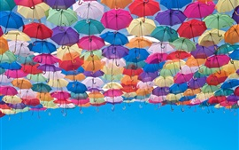 Preview wallpaper Colorful umbrellas, blue sky