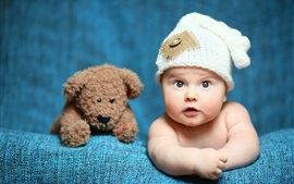 Preview wallpaper Cute baby and toy bear