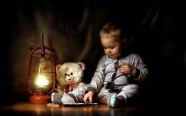 Cute little boy eat chocolate, teddy, lamp