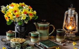 Daffodils, cups, milk, lamp, books, still life