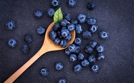 Fresh blueberries, spoon