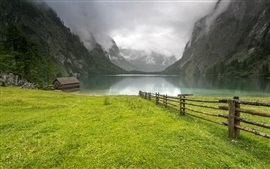 Preview wallpaper Germany, lake, mountains, grass, hut, fence, clouds