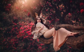 Preview wallpaper Girl, lying, tree, rabbit ears, flowers