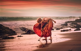 Preview wallpaper Girl, orange skirt, beach, sea, wind