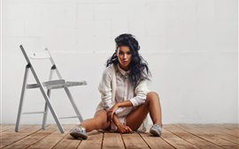 Preview wallpaper Girl sit on floor, curly hair, chair