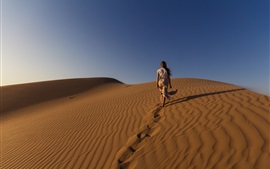 Girl walking in the desert, sands