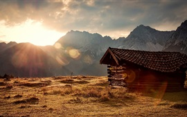Preview wallpaper Grass, mountains, sun rays, wood hut, morning