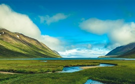 Iceland, beautiful nature landscape, mountains, grass, sea, clouds