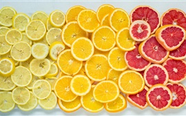Naranjas, pomelos, limones, rodajas de fruta