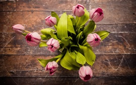 Pink tulips flowers, top view