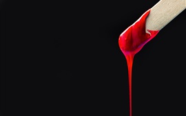 Red paint, wood stick, black background