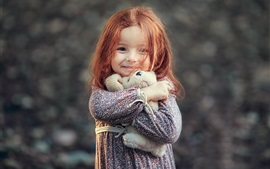 Preview wallpaper Smile little girl, red hair, toy