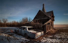 Wood house, broken car, snow, winter