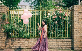 Preview wallpaper Beautiful young girl, flowers, fence, pink balloons