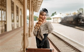 Preview wallpaper Blonde girl, curls, suitcase, rail station