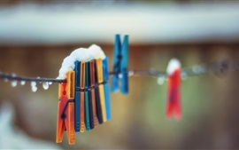 Preview wallpaper Clothespin, colorful, snow, rope