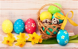 Colorful Easter eggs, yellow flowers, basket