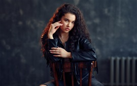 Preview wallpaper Curls girl, leather coat, chair