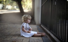 Preview wallpaper Cute baby girl, sit at street, fence