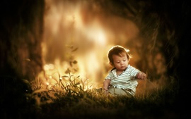 Preview wallpaper Cute little boy sit on grass ground, child