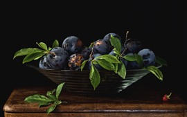 Preview wallpaper Fresh plums, bowl, black background
