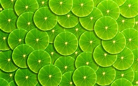 Preview wallpaper Green lemon slices background