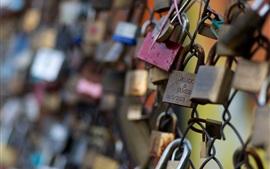 Many locks, wire fence