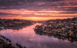 Preview wallpaper Portugal, Porto, Douro River, city, houses, red sky, clouds, sunset