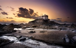 Preview wallpaper Portugal, beach, sea, stones, house, clouds, sunset