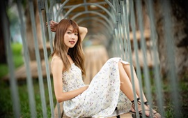 Preview wallpaper Pure Asian girl, skirt, sit on bench