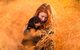 Red hair girl and dog, grass, nature