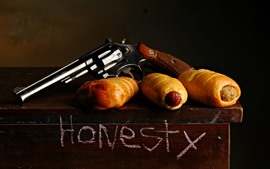 Preview wallpaper Revolver, weapon, bread